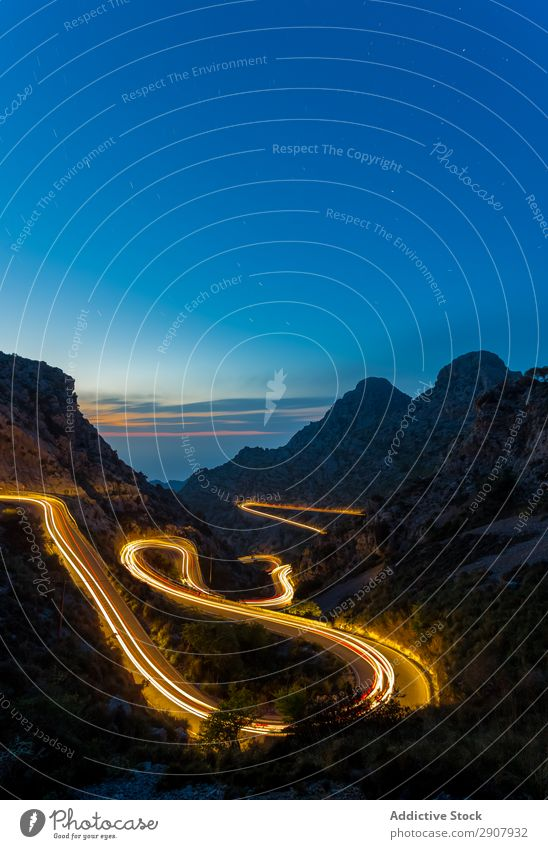 long exposure road at night between mountains Speed Red Light Transport Long Movement Street Exposure Night Scene way Colour Vacation & Travel Landscape Curve