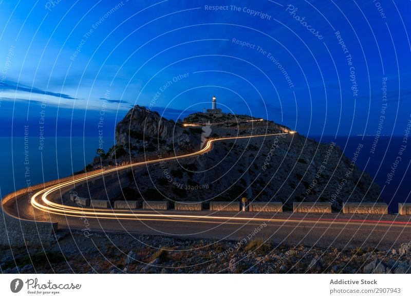 long exposure road at night with a light house in hill Speed Red Light Transport Long Movement Street Exposure Night Scene way Colour Vacation & Travel
