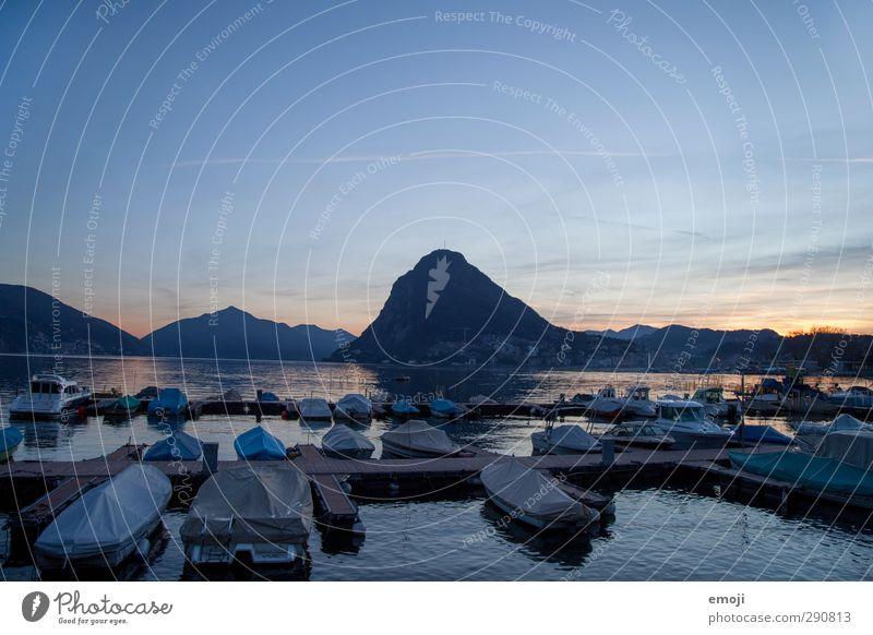 1500 Environment Nature Sky Cloudless sky Sunrise Sunset Hill Rock Mountain Lakeside Natural Blue Lugano Lake Lugano Jetty Harbour Watercraft Colour photo