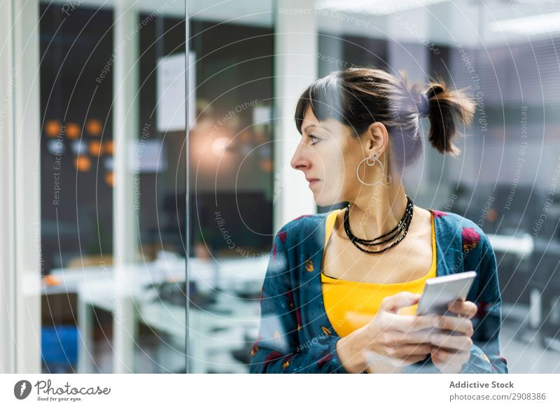 Woman browsing smartphone in office using PDA Office Glass Wall (building) Smiling Adults Modern Break Mobile Telephone Technology device Gadget Cheerful Joy