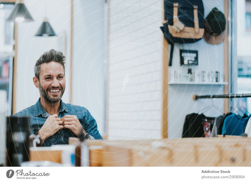 Man looking at mirror and touching beard in salon Beard checking Reflection handsome Style Professional Mirror Touch Looking Fashion Hair and hairstyles Adults