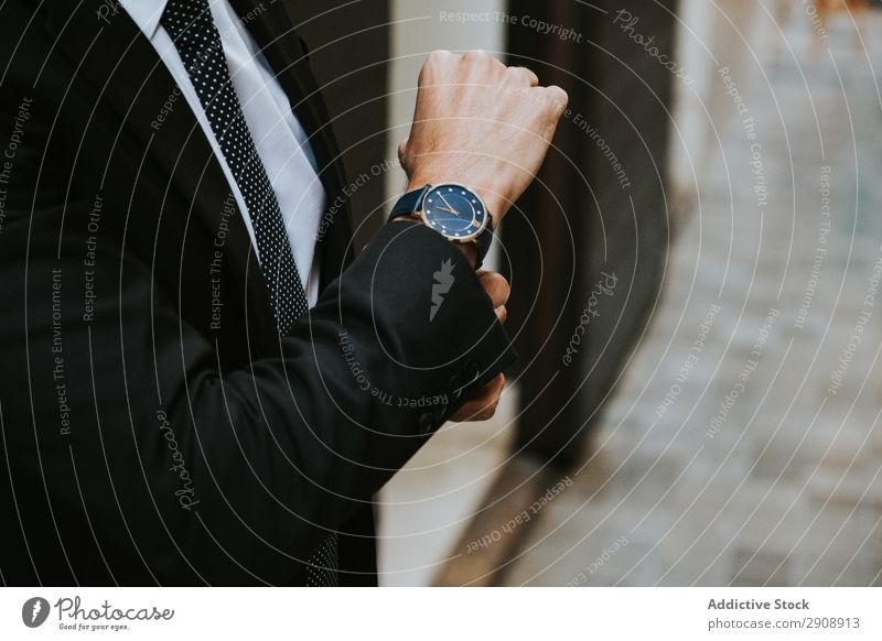 Young stylish man in costume with watch Man Businessman Observe Elegant Indicate Costume Suit Formal Youth (Young adults) Style Time Professional Success boss
