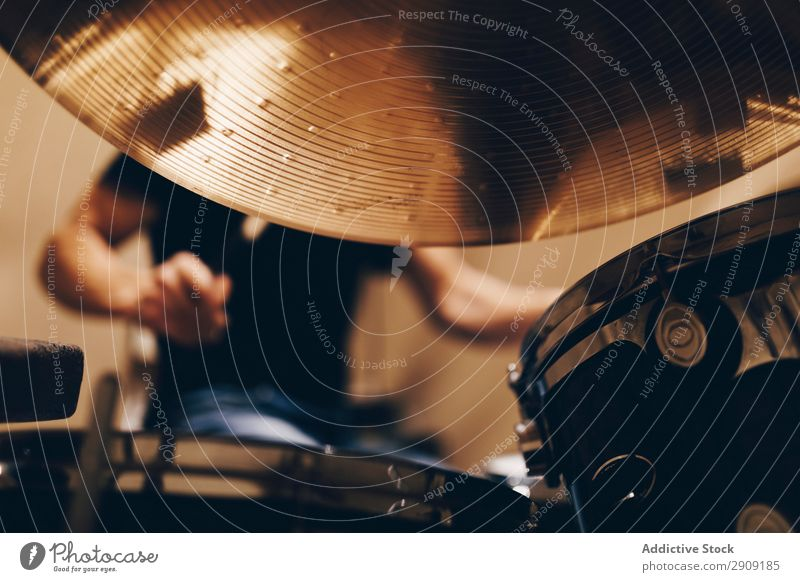 Man with headphones playing on drums Headphones Drum Playing Positive handsome Studio shot Music Professional Youth (Young adults) Drummer Equipment device