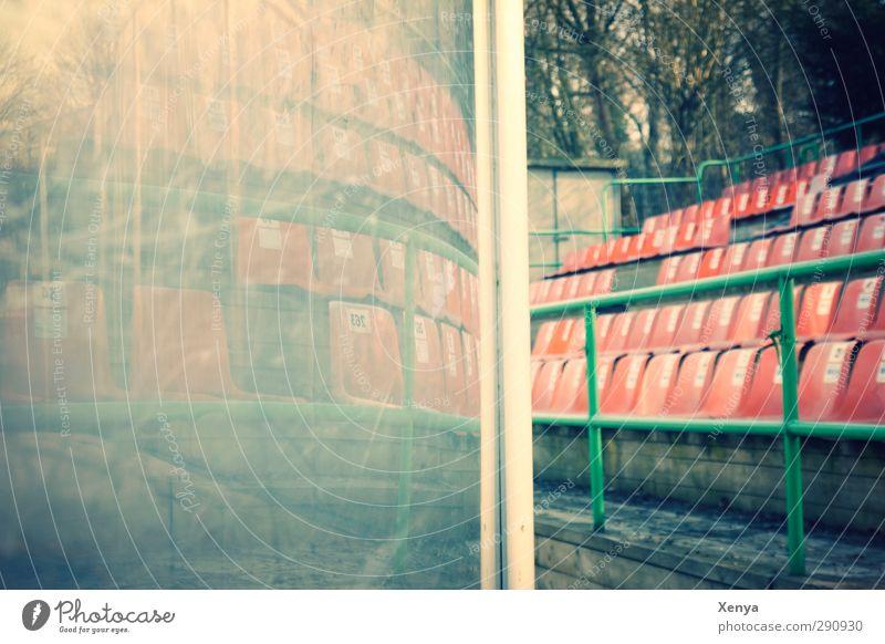 stadium Stands Stadium Ice stadium Deserted Plastic Retro Green Orange Reflection Seat end of game Window pane Scratched Exterior shot Copy Space left