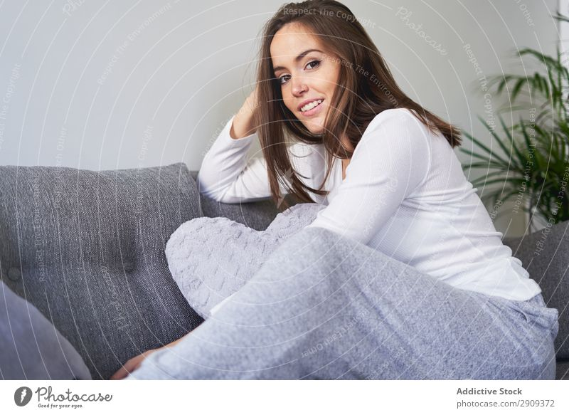 Smiling woman sitting on settee Woman Portrait photograph Home Settee Sit Resting Sofa Relaxation Happy Youth (Young adults) Attractive Volume knowledge