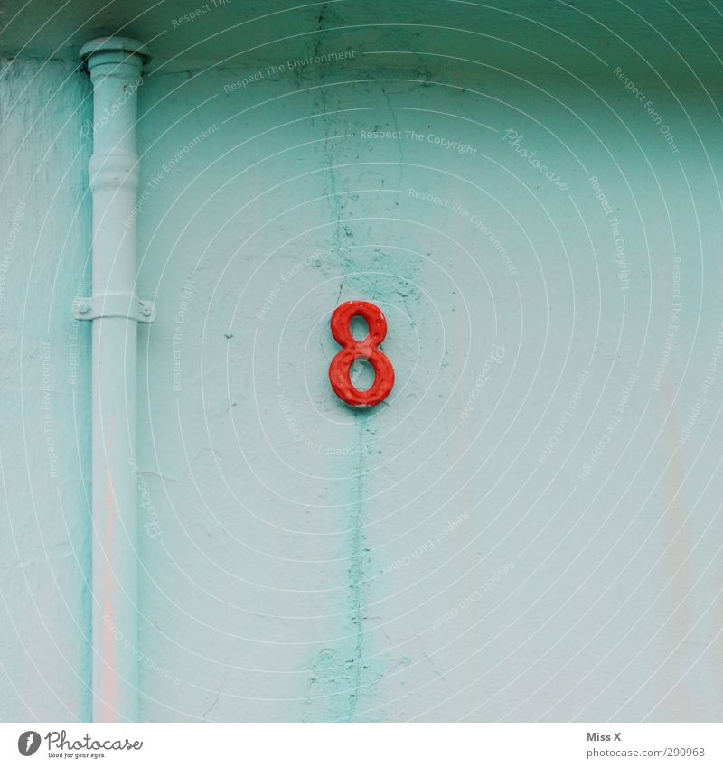 8 Sign Characters Signs and labeling Red Light blue House number Wall (building) Wall (barrier) Conduit Colour photo Multicoloured Exterior shot Deserted