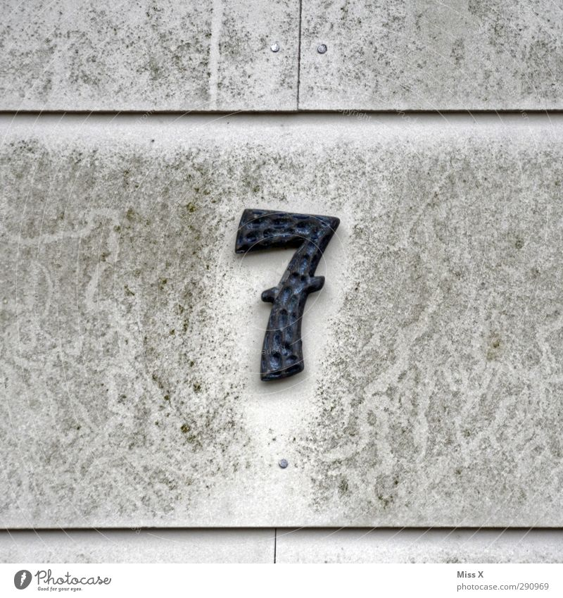 7 Sign Characters Signs and labeling Old Dirty Gray House (Residential Structure) House number Wall (building) Colour photo Subdued colour Exterior shot