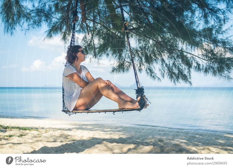 Woman in hammock near sea Hammock Ocean Beach Relaxation Thailand Sunbeam Day Barefoot Vacation & Travel Paradise Summer Rest Lifestyle Leisure and hobbies