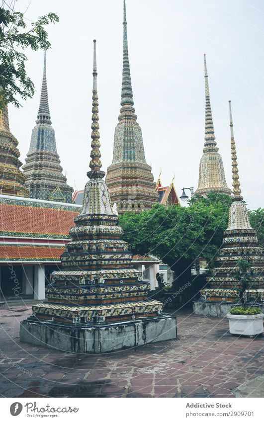 Pyramids in yard of oriental temple Temple Thailand Ornament decor Asia Culture Ancient Tradition Religion and faith Architecture Landmark Building