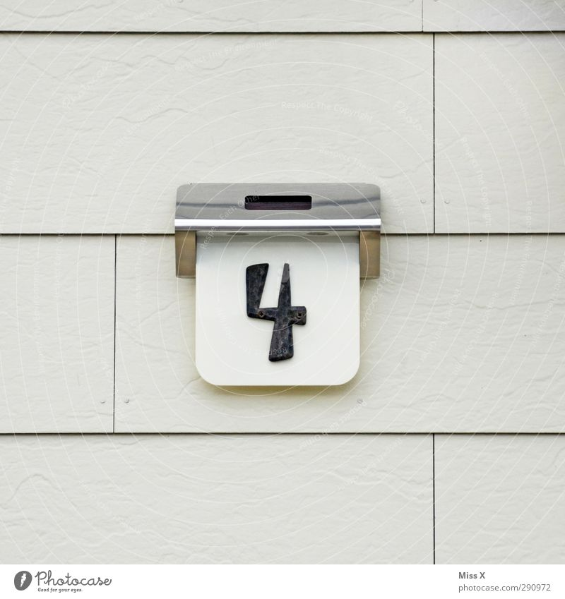 4 Sign Characters Signs and labeling Gray House number House (Residential Structure) Wall (building) Colour photo Exterior shot Close-up