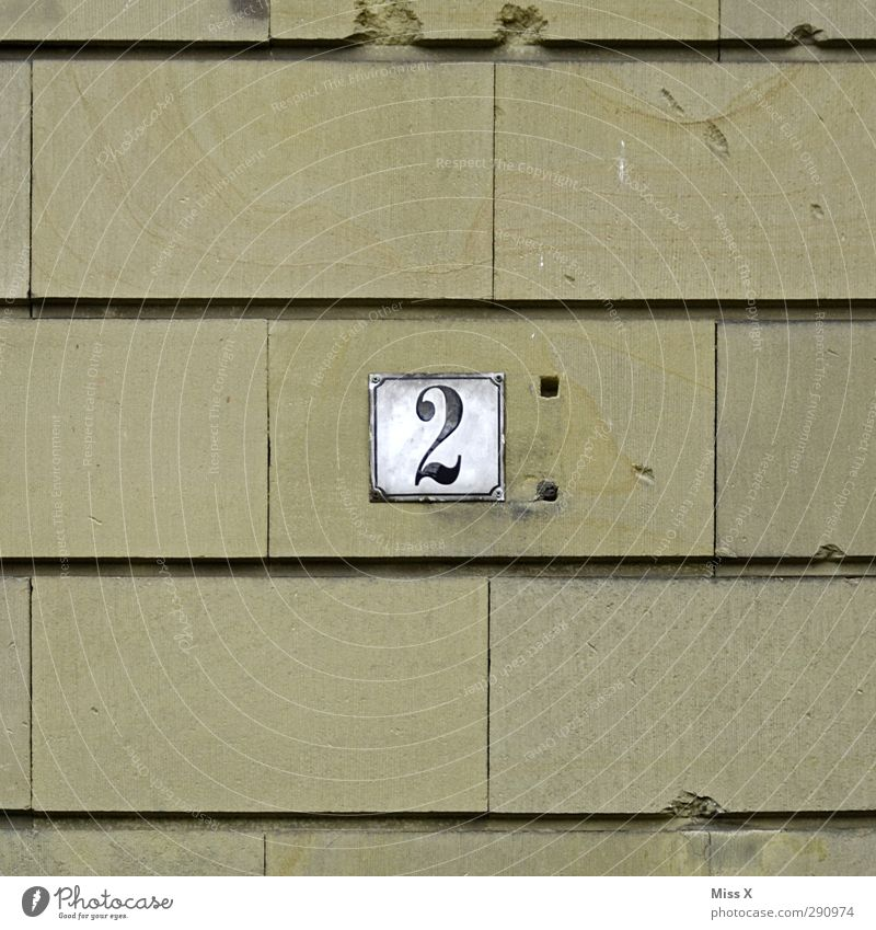 2 Sign Characters Old House number Stone wall Wall (building) House (Residential Structure) Signs and labeling Hollow Colour photo Exterior shot Close-up
