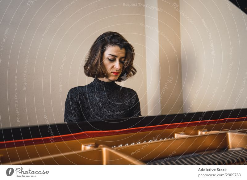 Young woman playing a piano at home Fiddle Playing Music Violinist Orchestra instrument Classical Musician Hand Musical Human being String Performance Bow
