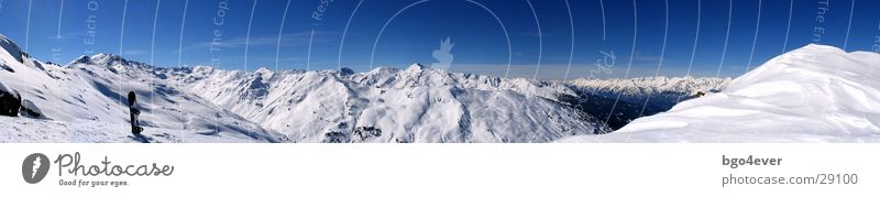 Mountain Snow Large Beautiful weather Break Snowcapped peak Panorama (Format) Snowscape Valley Blue sky Snowboard Winter vacation Gorgeous Mountain range Winter's day
