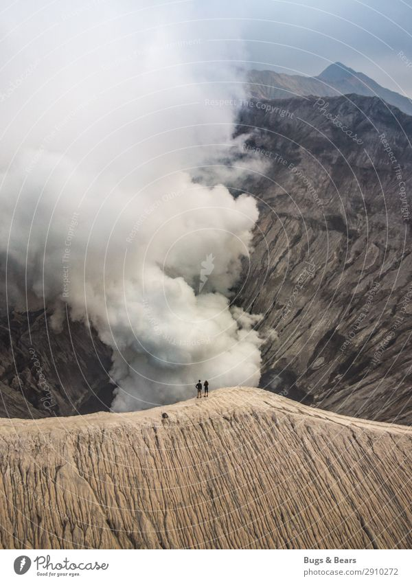 clouds of smoke Couple Partner 2 Human being Environment Nature Landscape Elements Fire Climate Mountain Peak Volcano bromo Adventure Uniqueness Discover Smoke