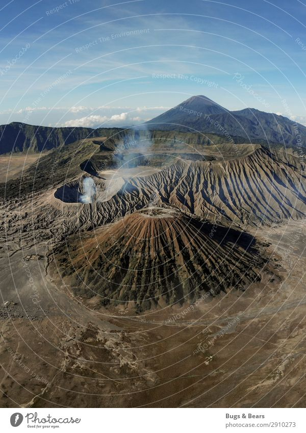 The earth trembles Environment Nature Landscape Elements Earth Sand Mountain Peak Volcano bromo Adventure Indonesia Smoke Vantage point drone