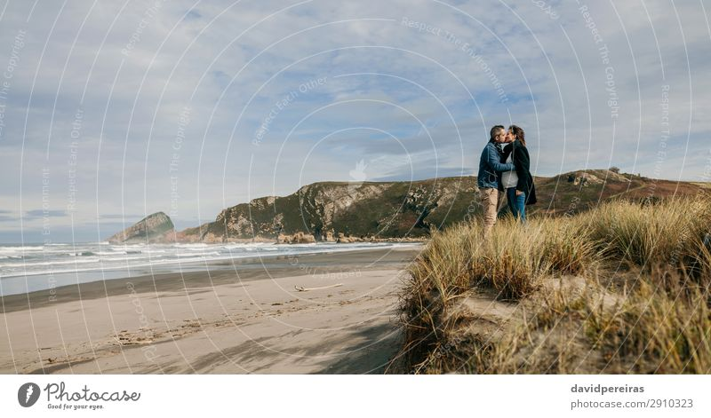 Couple kissing on the beach Lifestyle Calm Leisure and hobbies Beach Ocean Waves Winter Woman Adults Man Parents Family & Relations Nature Landscape Sand Autumn