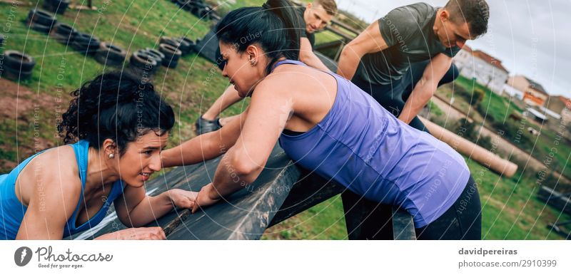 Participants in obstacle course climbing pyramid obstacle Sports Climbing Mountaineering Internet Human being Woman Adults Man Group Authentic Strong Effort