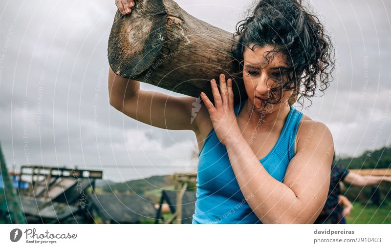 Woman carrying a trunk Sports Human being Adults Carrying Authentic Strong Power Effort Competition obstacle course race Tree trunk overcoming Load Log weight
