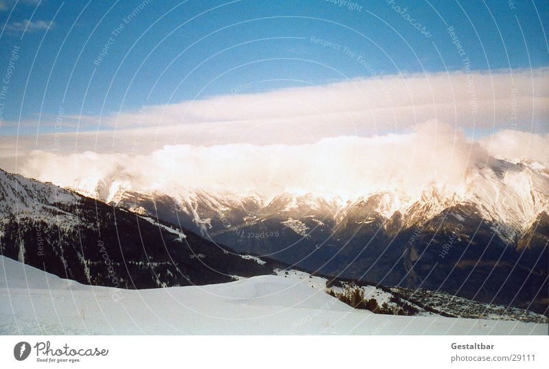 The mountain calls_1 Mountain range Switzerland Winter Cold Clouds Alps Snow Vantage point Tall Blue sky clear vision