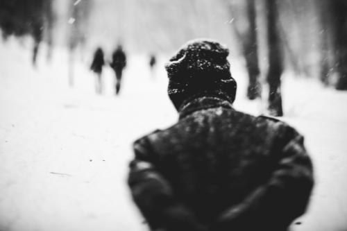 colder Human being 3 Winter Weather Snowfall Forest Coat Cap Going Walking Cold lensbaby To go for a walk Black & white photo Exterior shot Day Blur