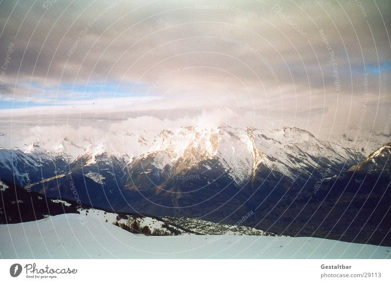 Winter Clouds Cold Snow Mountain Tall Vantage point Switzerland Alps Blue sky Mountain range Formulated