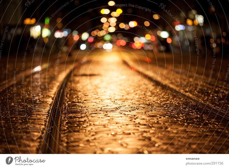City Loneliness Dark Yellow Street Stone Lamp City life Illuminate Transport Empty Wet Soft Downtown Railroad tracks Old town