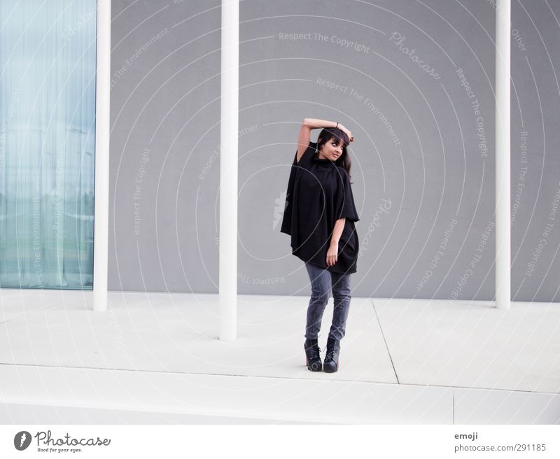 move Feminine Young woman Youth (Young adults) 18 - 30 years Adults Wall (barrier) Wall (building) Facade Fashion Cape Hip & trendy Beautiful Posture