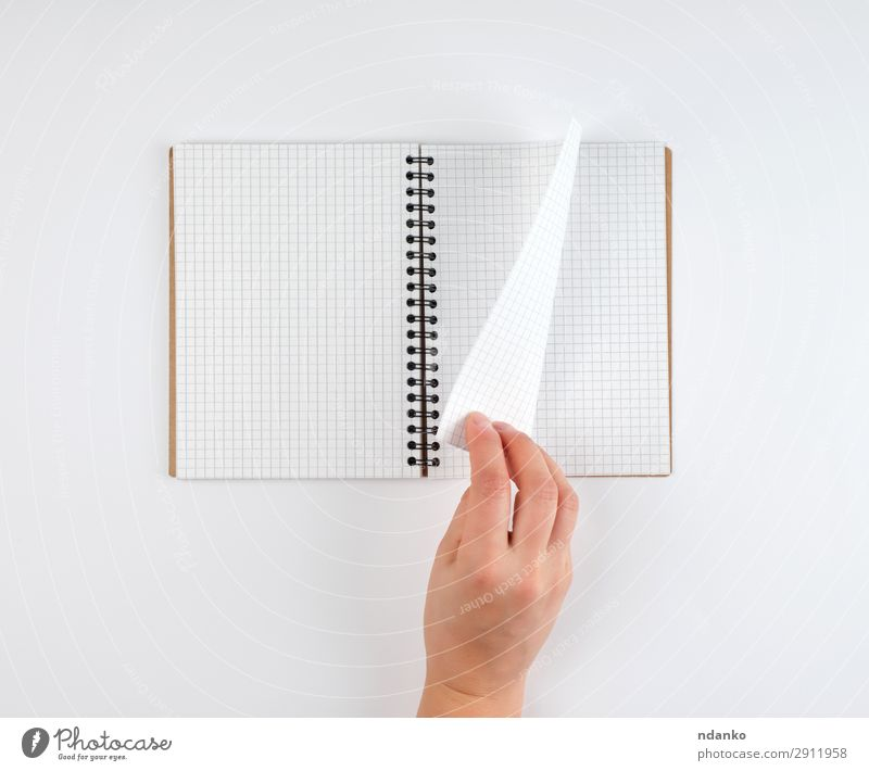empty open notebook in a cell and a female hand Education School Study Office Business Human being Woman Adults Arm Hand Book Paper Pen Write White background