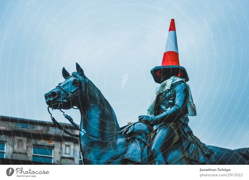 Rider statue with cone of guidance on the head Construction site Art Fog Hat Road sign Cold Funny Point Blue Red Glasgow Great Britain Scotland Blind