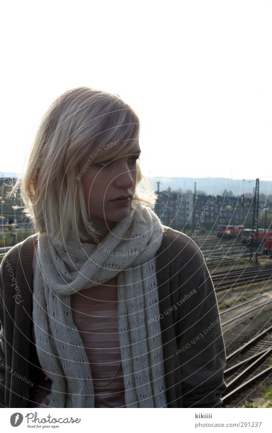 Quick Scarf Sit Railroad Railroad tracks Sky Bridge House (Residential Structure) High-rise Town Train station Look back Looking Girl Blonde Wait Hope