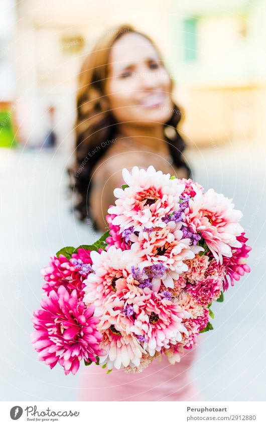A young woman holding a bouquet of wildflowers in her hands Lifestyle Elegant Style Happy Beautiful Freedom Summer Human being Woman Adults Nature Flower