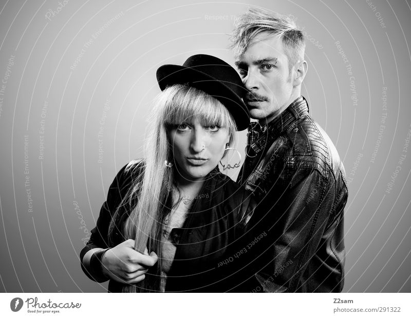 Human being Youth (Young adults) Adults 18 - 30 years Style Couple Fashion Together Blonde Stand Cool (slang) Uniqueness To enjoy Smoking Rock music Hat