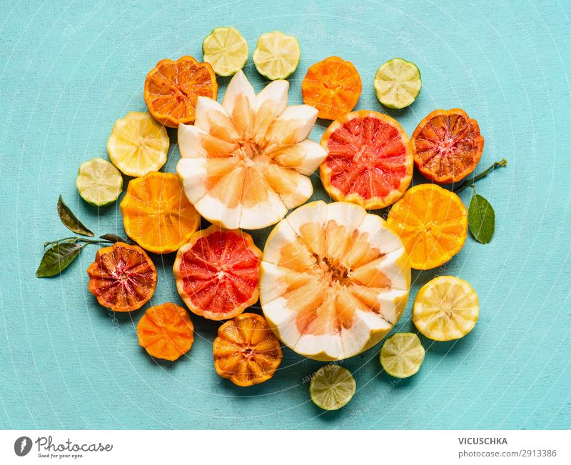 Various citrus fruits on a light blue background Food Fruit Orange Nutrition Organic produce Shopping Style Design Healthy Healthy Eating Yellow Composing