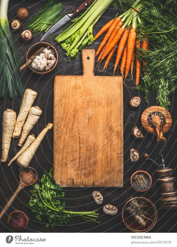 Food background with cutting board Vegetable Lettuce Salad Herbs and spices Cooking oil Nutrition Organic produce Vegetarian diet Diet Crockery Shopping Style