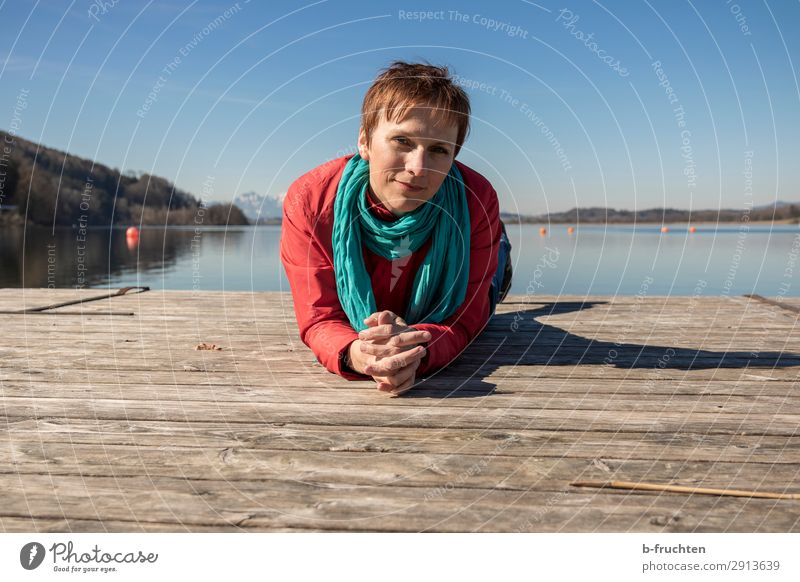 Woman on wooden walkway, spring day at the lake Leisure and hobbies Vacation & Travel Tourism Adults Face Arm 1 Human being 30 - 45 years Nature Water Spring