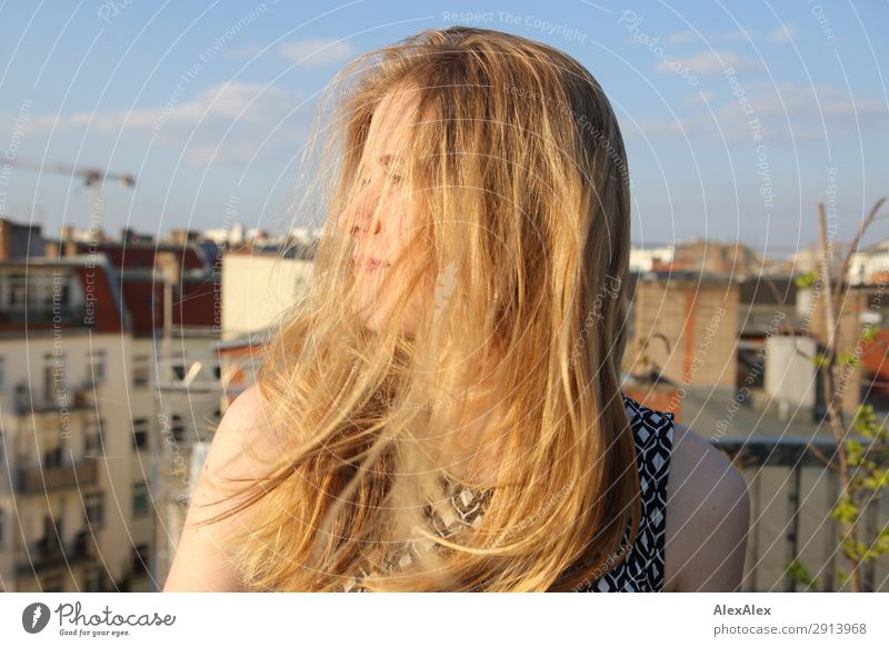 Blond girl with blowing hair on roof terrace Lifestyle Style Joy Beautiful Young woman Youth (Young adults) Hair and hairstyles 13 - 18 years Youth culture