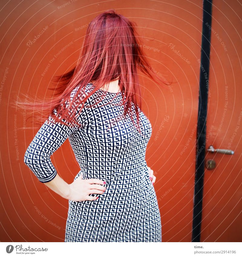 Torque (I) Feminine Woman Adults 1 Human being Wall (barrier) Wall (building) Door Dress Red-haired Long-haired Rotate To hold on Stand Authentic Beautiful Town