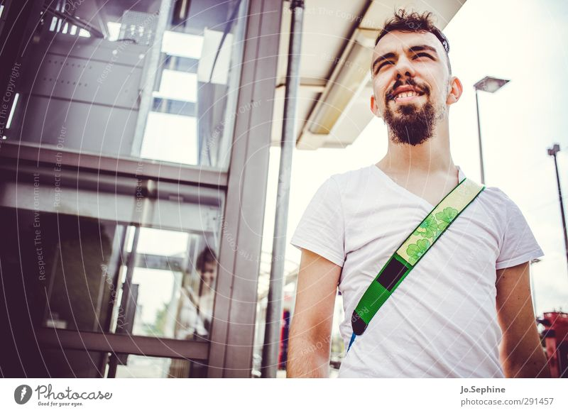 watch that man Lifestyle Style Summer Masculine Young man Youth (Young adults) 1 Human being 18 - 30 years Adults T-shirt Facial hair Observe smile Looking Wait
