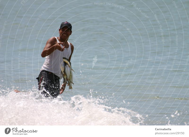 Man Ocean Waves Fish Fisherman