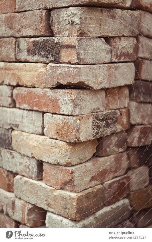 builds again on IV Manmade structures Wall (barrier) Wall (building) Facade Stone Brick Old Dirty Sharp-edged Corner Stack Tidy up Build Construction site