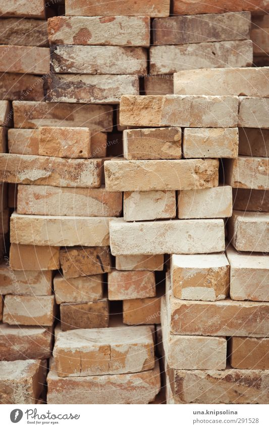 builds again on III Manmade structures Wall (barrier) Wall (building) Stone Brick Dirty Sharp-edged Stack Build Tidy up Construction site Material Colour photo