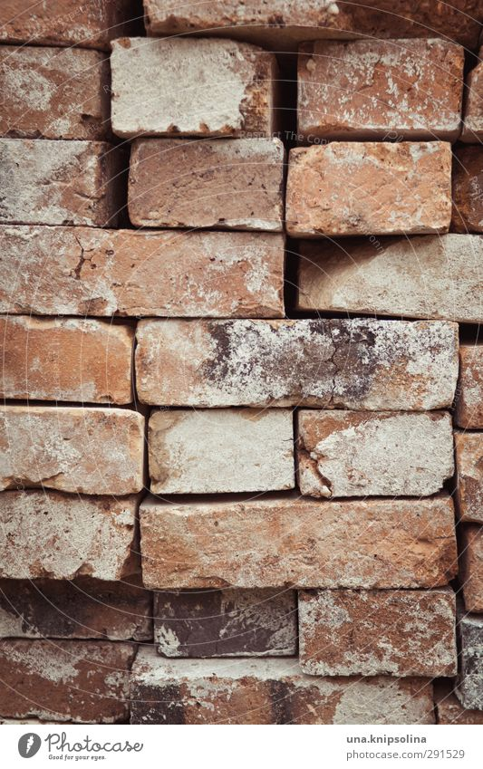 builds again on II Manmade structures Wall (barrier) Wall (building) Stone Brick Dirty Sharp-edged Stack Tidy up Build Construction site Material Colour photo