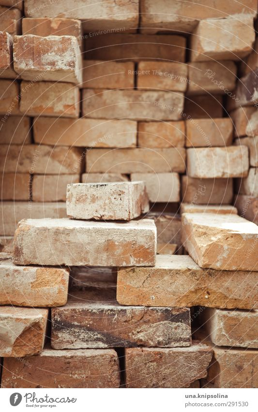 builds again on I Manmade structures Wall (barrier) Wall (building) Stone Brick Sharp-edged Stack Tidy up Build Construction site Material Bricklayer