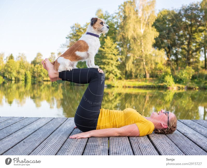 Young woman doing yoga with dog Lifestyle Fitness Leisure and hobbies Summer Yoga Feminine Youth (Young adults) 1 Human being 18 - 30 years Adults Water Sky