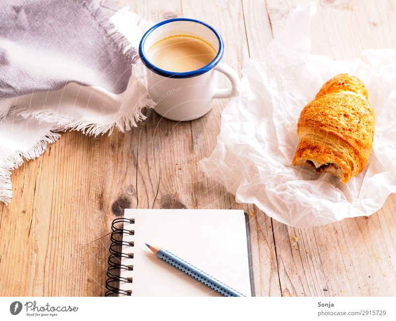Coffee break with croissant Food Dough Baked goods Croissant Nutrition Breakfast To have a coffee Beverage Hot drink Mug Stationery Paper Piece of paper Pen