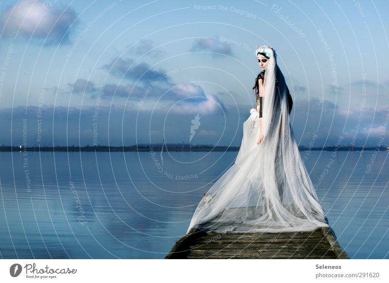 -6° Winter Human being Feminine Woman Adults 1 Environment Nature Landscape Water Sky Clouds Coast Lakeside River bank North Sea Baltic Sea Fashion Clothing