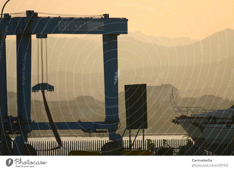 Fog Harbour Dusk Crane Sardinia Evening sun Shipyard Environment Nature