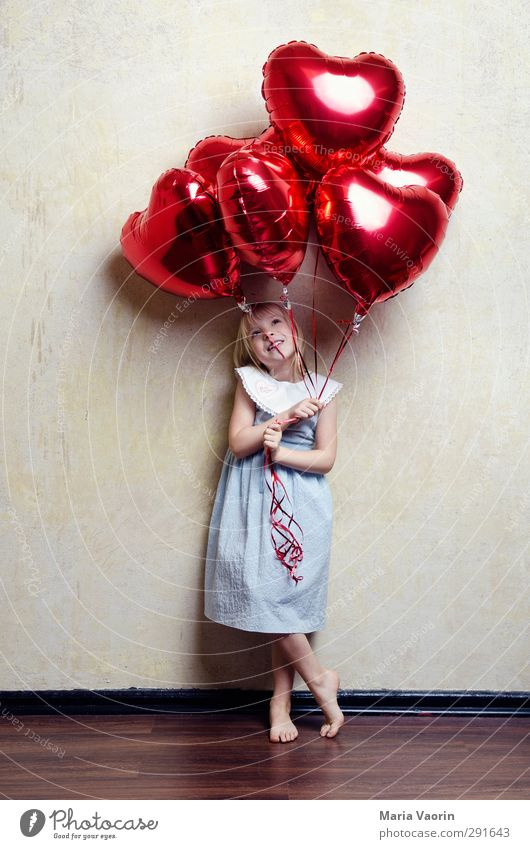Human being Child Girl Love Feminine Happy Infancy Flying Heart Smiling Happiness Cute Observe Balloon Dress Joie de vivre (Vitality)