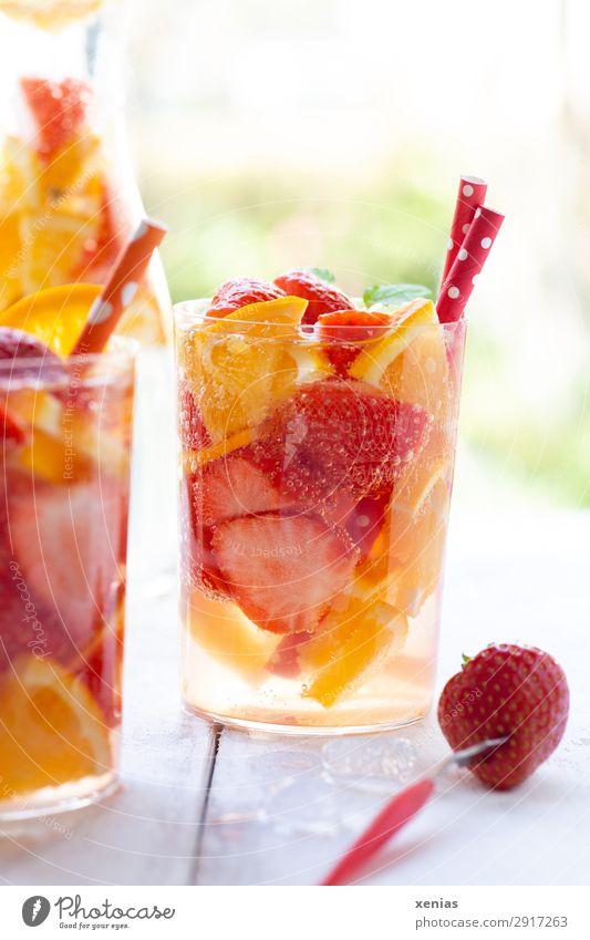 Summer refreshment with orange and strawberries Fruit Orange Strawberry Organic produce Vegetarian diet Beverage Cold drink Drinking water detox drink Bottle