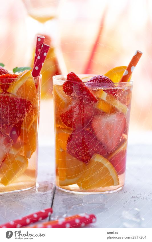 Fruity refreshing drink with strawberries and orange Orange Strawberry Organic produce Vegetarian diet Diet Beverage Cold drink Drinking water Glass